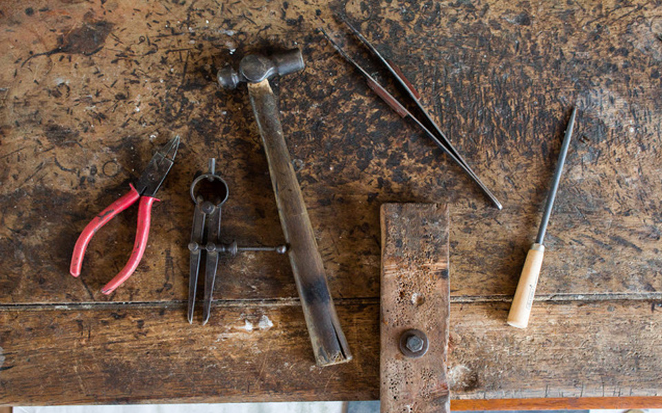 photo of old tools on a wooden table