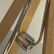 photo of a silver stem bead on a chain