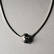 photo of silver chain with flower bead