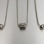 photo of three silver chains