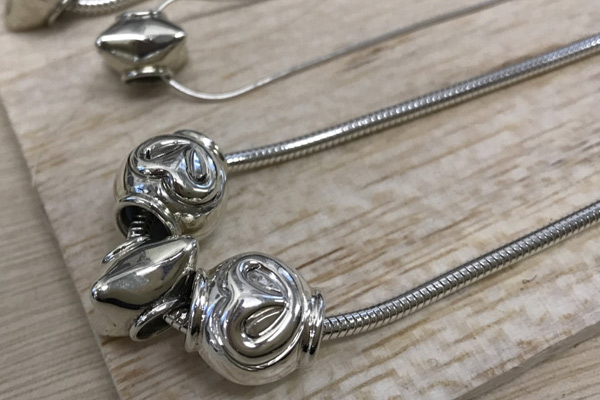 photo of beads on silver chains