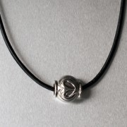 photo of leather necklet with heart bead