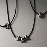 photo of three leather necklets with beads