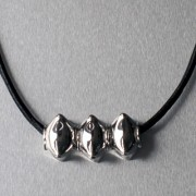 photo of leather necklet with three star beads