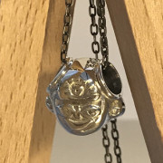 photo of a silver warrior head bead on an oxidised metal chain