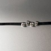 photo of leather strap with four hand beads