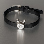 photo of leather strap with owl bead