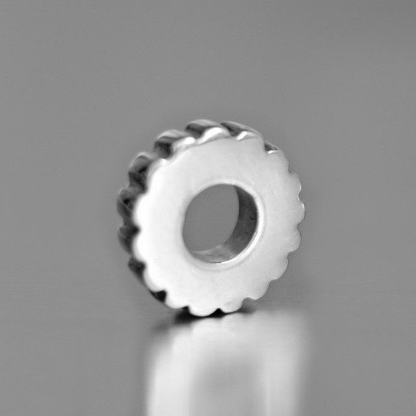 photo of a silver wheel bead