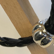 Leather bracelet with silver bead charm