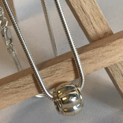 photo of a silver snake chain