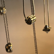 photo of a group of silver chains hanging down